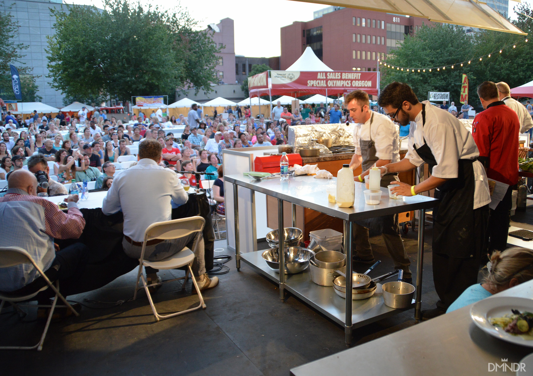 Oregon Iron Chef Competition winners at work looking out at the crowd