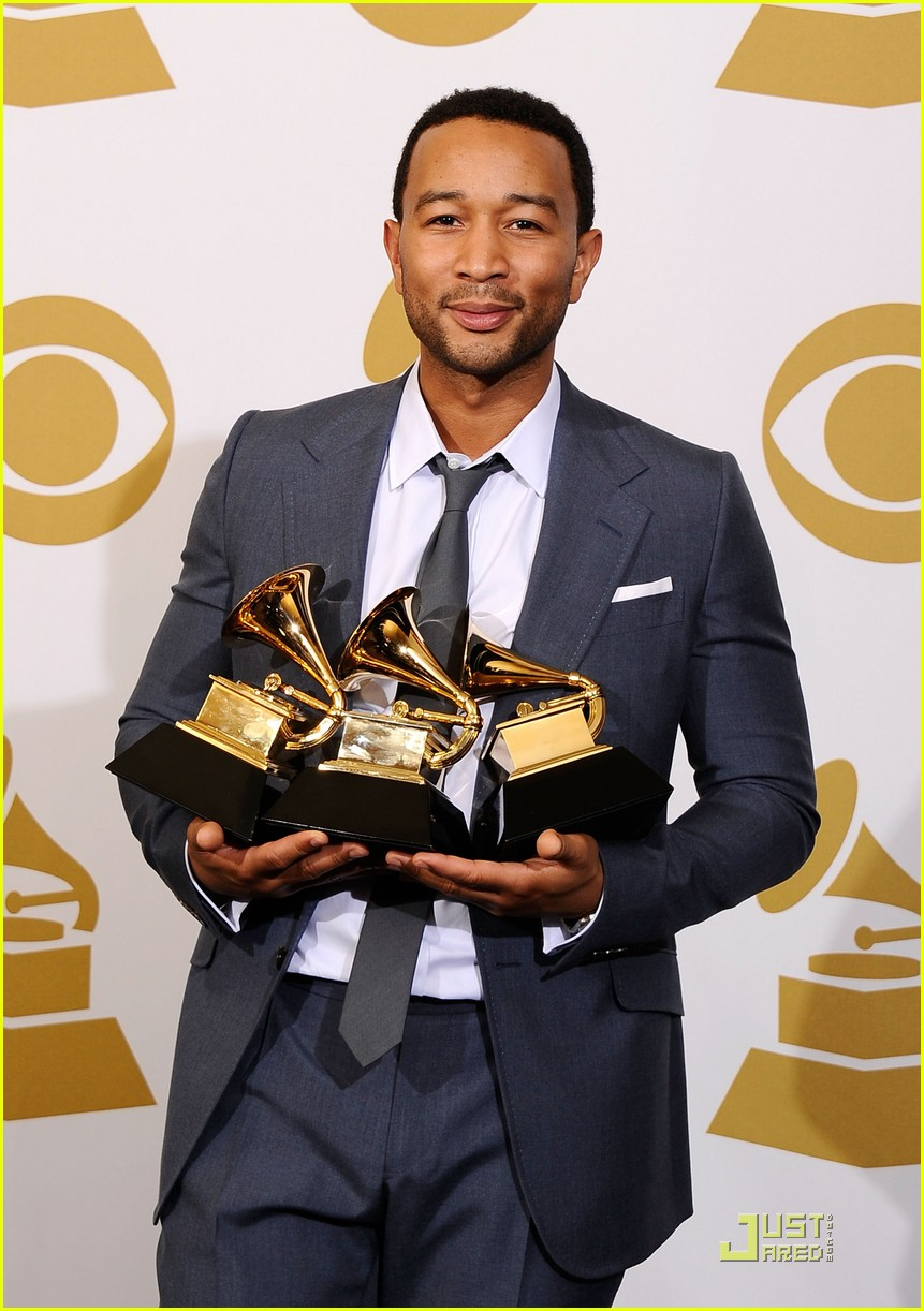 "LOS ANGELES, CA - FEBRUARY 13: Musician John Legend, winner of the Best R&B Album award for ""Wake Up!"" and Best R&B Song award for ""Shine"" and the Best Traditional R&B Vocal Performance award for """"Hang on in There"""" poses in the press room at The 53rd Annual GRAMMY Awards held at Staples Center on February 13, 2011 in Los Angeles, California. (Photo by Kevork Djansezian/Getty Images)"